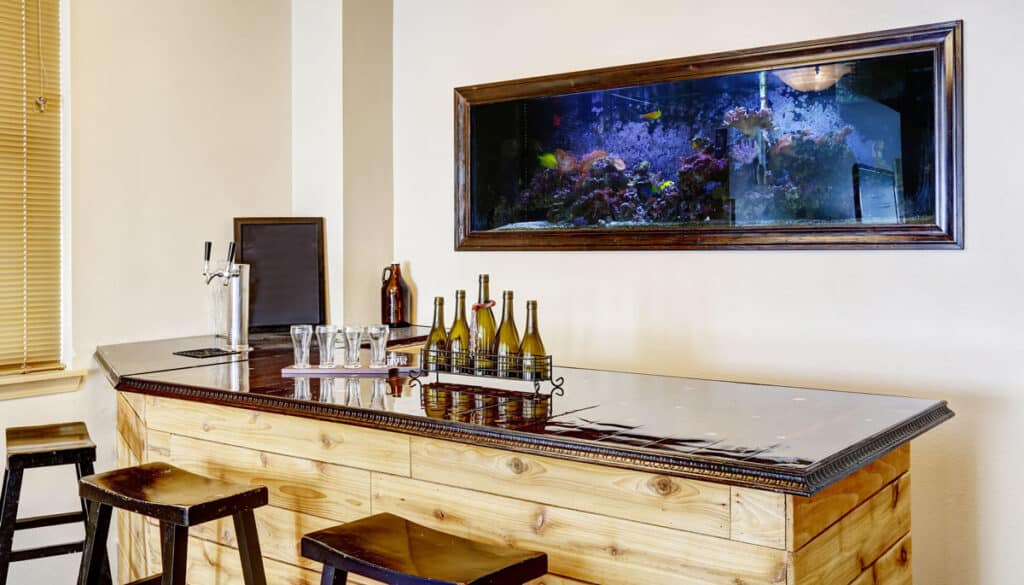 View of a home bar with an aquarium